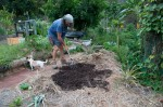 Spreading out compost to create another garden bed