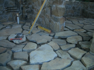 The rock puzzle, some already cemented in, some still awaiting fixture