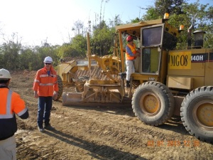 Management negotiating the use of the grader to rip and mound the site