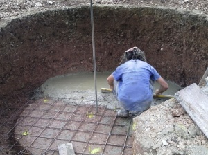 Starting the concreting, constantly leveling the concrete to ensure a straight and level floor.