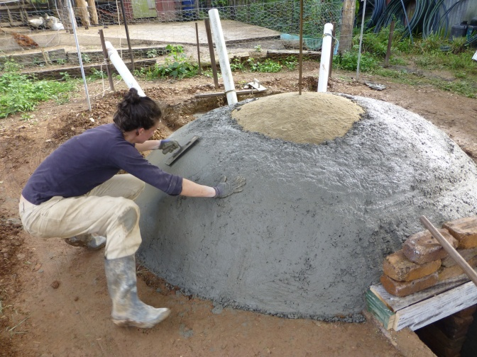 Biogas project, prevention of concrete cracking by working the concrete whilst wet.