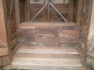 Finished bench seat of the outhouse up close