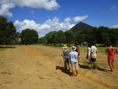 Tom Kendall from the Permaculture Research Institute Sunshine Coast explaining the swale and spillway