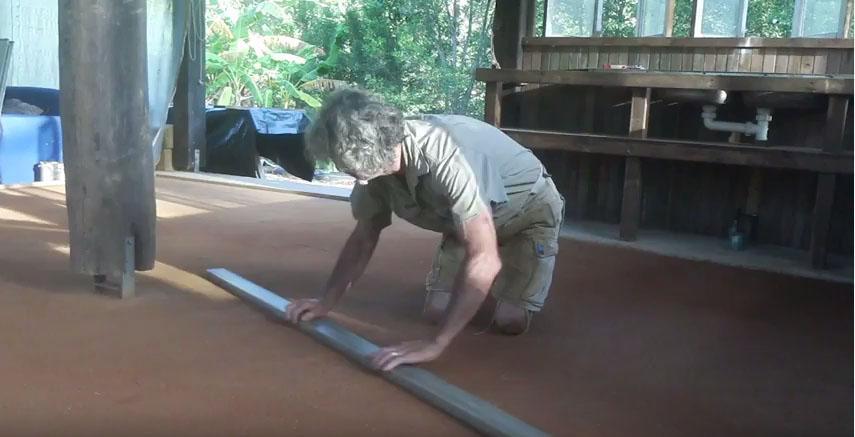 Tom Kendall works his earthen floor, PRI Sunshine Coast