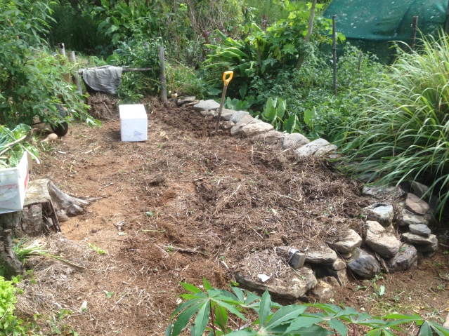 Tom Kendall prepares garden beds for planting garlic on his permaculture designed property.