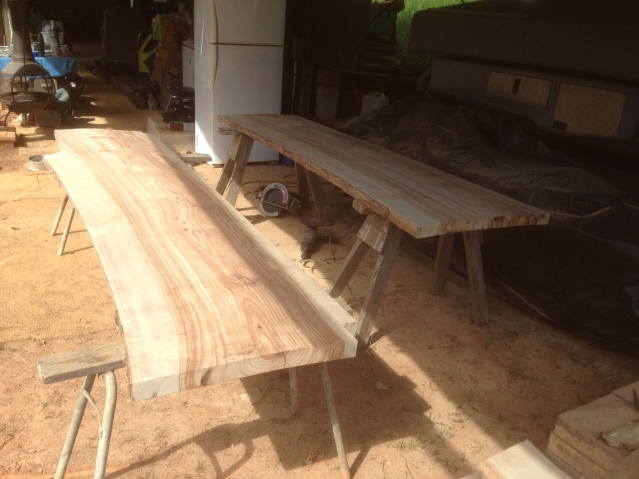 Tom Kendall shapes timber slabs for his kitchen benchtops at Maungaraeeda.