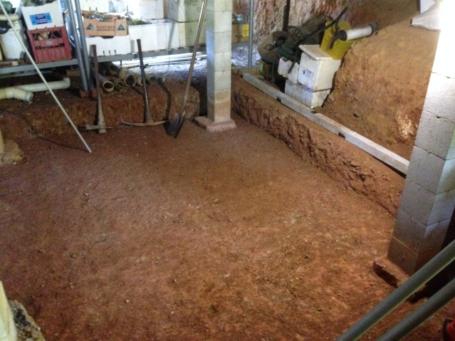 Tom Kendall excavates to create a room under his house at Maungaraeeda.