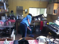 Isa sweeping the main house