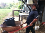 Happy Em wheeling the second composting toilet